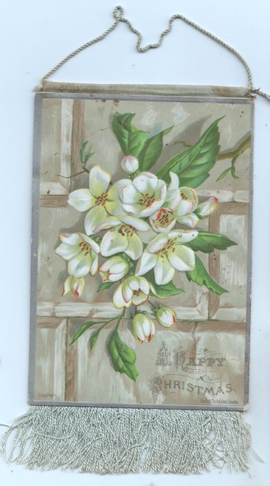 A HAPPY CHRISTMAS white blossoms, trellis behind