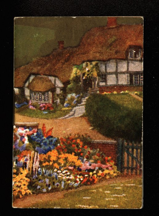 garden and gate with large cottage behind