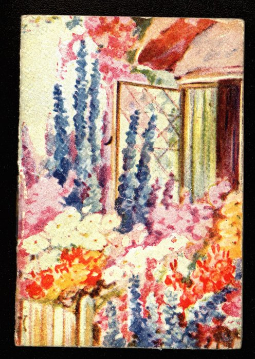 flowers in front of open cottage window