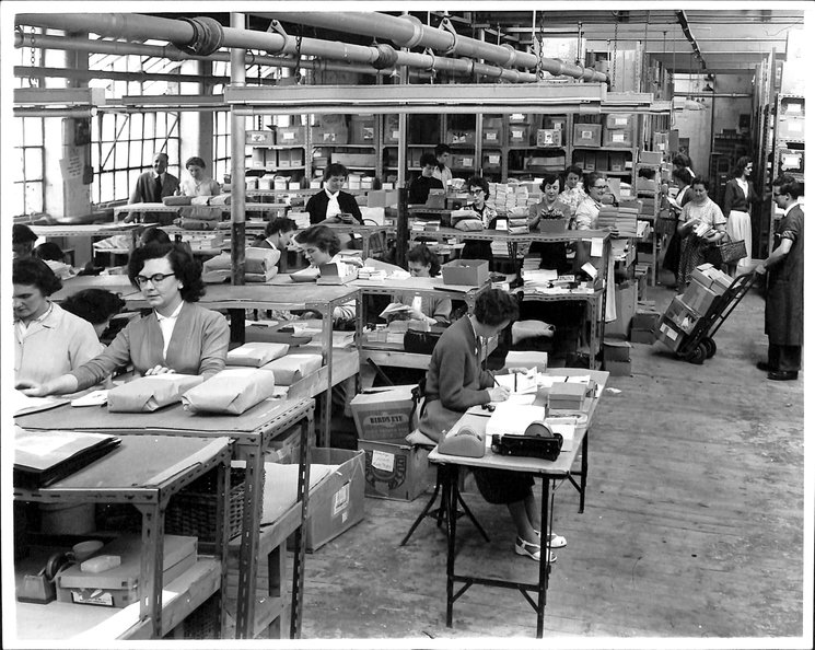 workers preparing smaller packages for shipment
