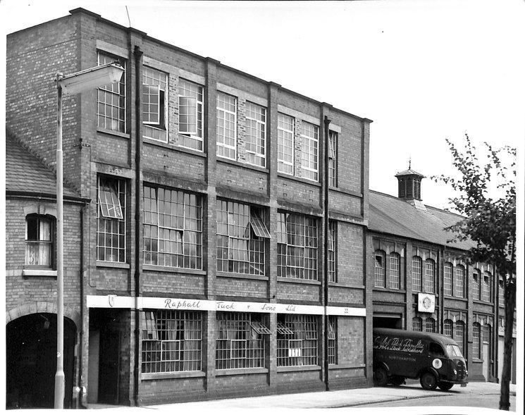 van leaving three-story factory