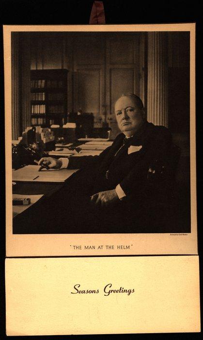 THE MAN AT THE HELM Churchill sitting at his desk smoking a cigar