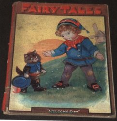 FAIRY TALES young child reaching down to cat on hind legs