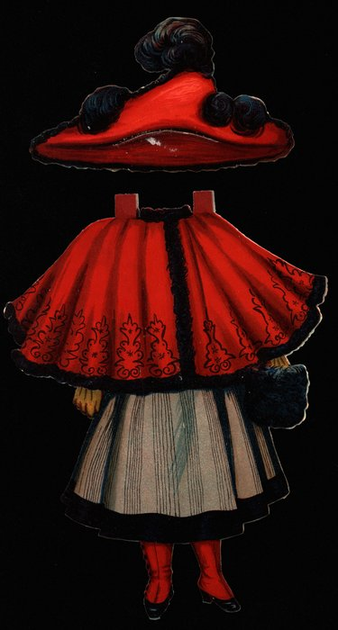 red and black cape and hat, light brown skirt with stripes