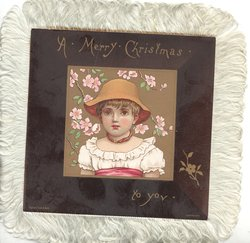 A MERRY CHRISTMAS TO YOU on wide black margins, head & shoulders of girl in yellow hat, facing front, floral background