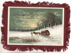 A HOLY AND HAPPY CHRISTMAS man walking ahead of two horse wagon in the snow, moonlit scene