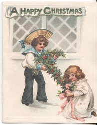 A HAPPY CHRISTMAS boy and girl setting up holly decorations