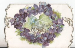 GREETINGS on ivy leaf, surrounded by ring of violets