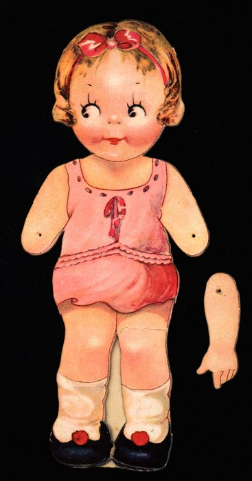 doll with brown hair and black shoes