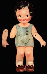 doll with black hair and brown shoes