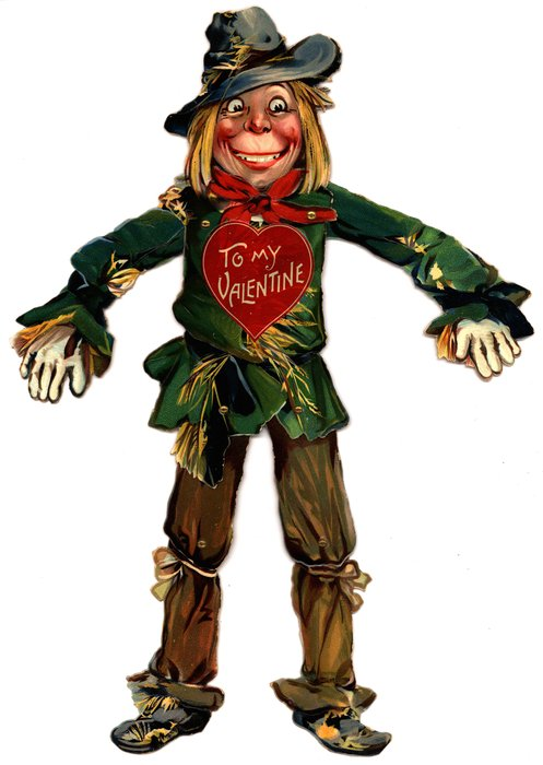 scarecrow with a green shirt, brown pants and grey hat