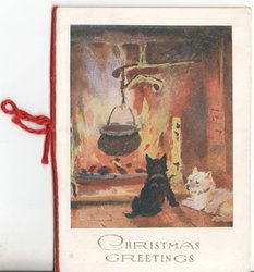 CHRISTMAS GREETINGS two digs sit in front of fireplace