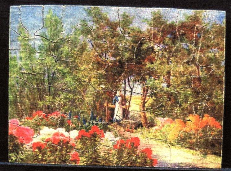 GARDEN GLORIES, woman in an English garden by a gate