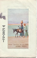 EGYPT to left of two people and donkey, WATER CARRIERS ON THE NILE UPPER EGYPT