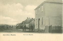 UNE RUE DE MIQUELON large house right, people mid-distant