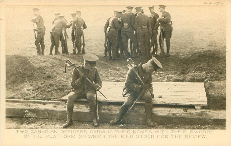 TWO CANADIAN OFFICERS CARVING THEIR NAMES WITH THEIR SWORDS ON THE PLATFORM ON WHICH THE KING STOOD FOR THE REVIEW