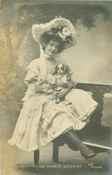 MISS MARIE GEORGE small spaniel on her lap,