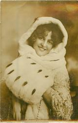 MISS MARIE STUDHOLME, standing facing front, large muff & fur cape