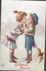 boy & girl kiss, girl carrying two coloured eggs, chick pulls at his clothes