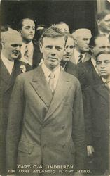 CAPT. C.A. LINDBERGH  facing camera, crowd of people behind