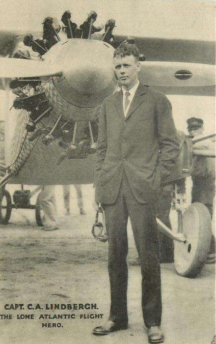CAPT. C.A. LINDBERGH  goggles in hand, plane behind