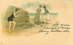 IF YOU HAVEN'T ANYTHING BETTER ON  two women scrutinise the clothes of man in bathing suit