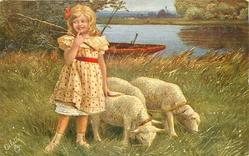 girl in yellow dress with red spots stands left of three lambs, holds their leash in her hand