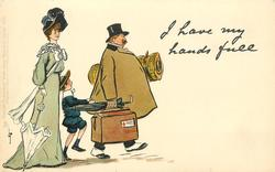 I HAVE MY HANDS FULL  morose man carries luggage, boy hanging to his coat & elegant lady follows