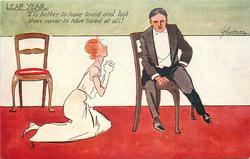 'TIS BETTER TO HAVE LOVED AND LOST THAN NEVER TO HAVE LOVED AT ALL!  woman kneels on floor beside scowling seated man