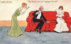"""YOU KNOW YOU ARE ENGAGED TO ME!""  unnatractive lady peers at her dance programme, startled man on couch recoils, pretty girl on other end of couch"