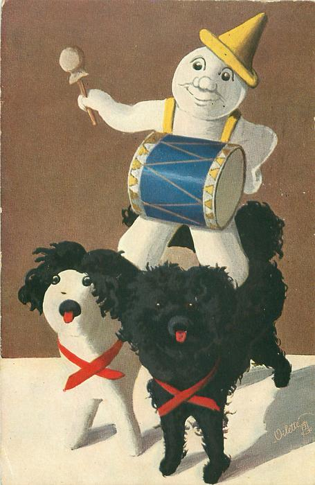 snow clown plays drum whilst riding pair of toy dogs, one black-one white