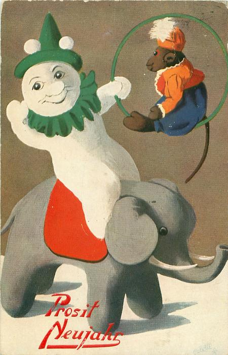 snow clown, holding monkey perched in a hoop, whilst riding on back of toy elephant