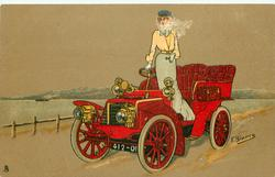 lady standing in red car