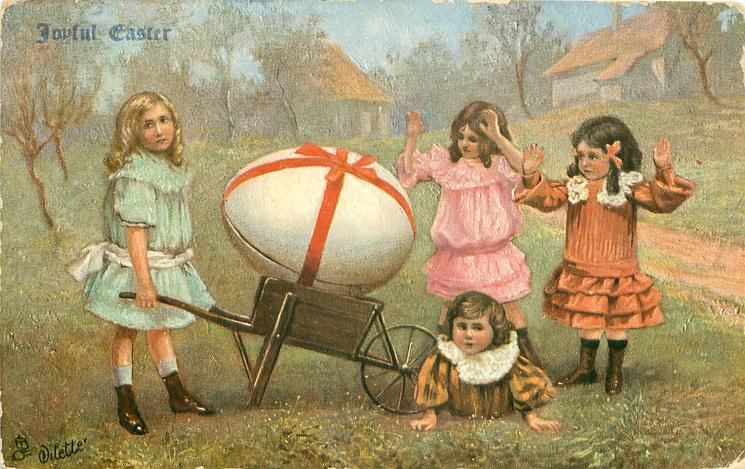 girl pushes wheel-barrow with enormous EASTER egg, two girls admire it, another on ground