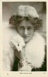 MISS PHYLLIS DARE  head & shoulders study, wearing fox fur, facing & looking front