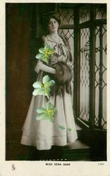 MISS ZENA DARE  standing in front of window, facing half right looking front