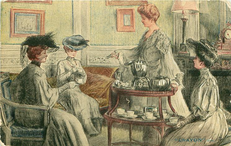 woman stands behind table with tea service on it, three others sit holding tea cups