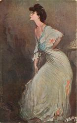 TANZPROBE  woman in blue dress stands facing left, eyes closed, her left hand on hip, right hand on thigh