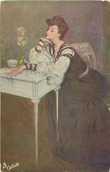 lady in long dark dress with white sleeves,sits with eyes closed & both elbows on table, facing left