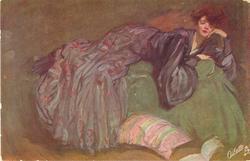 lady in long purple dress reclines on sofa