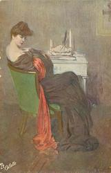 lady in off shoulder long purple dress, with red scarf sits in green chair at white table