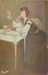 TRAUMERIE  lady in long dark dress with white sleeves,sits with eyes closed & both elbows on table, facing left