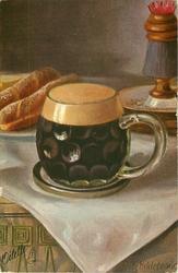 squat glass of dark beer, bread rolls behind left, match-holder behind right