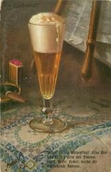 tall glass of light beer, smoking cigar in match holder, on blue & white table cloth