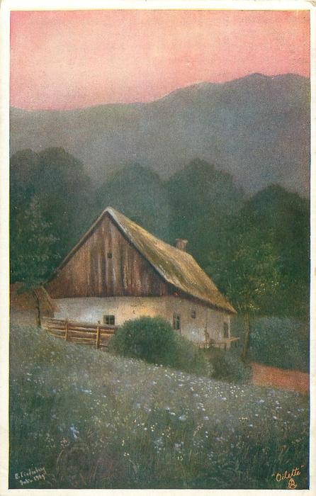 cottage behind grassy field with many blue flowers, trees & distant mountains behind