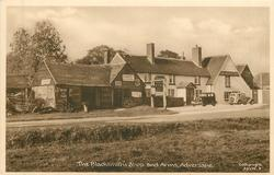 THE BLACKSMITH'S SHOP AND ARMS