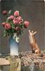 many red roses in blue /white  vase on table  next to china fox looking up