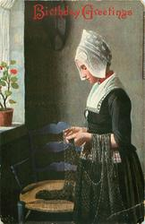 THE FISHERMAN'S DAUGHTER  woman stands examining a net