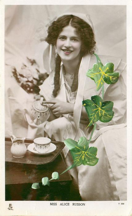 MISS ALICE RUSSON  sitting by table pouring tea