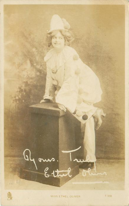 MISS ETHEL OLIVER  climbing onto pedestal in clown costume, looking right & up